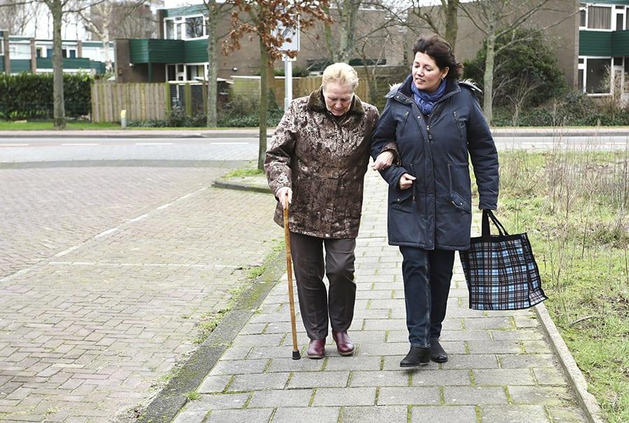Two women walking outside together in winter
