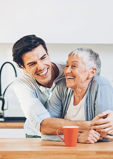 male hugging onto elderly female