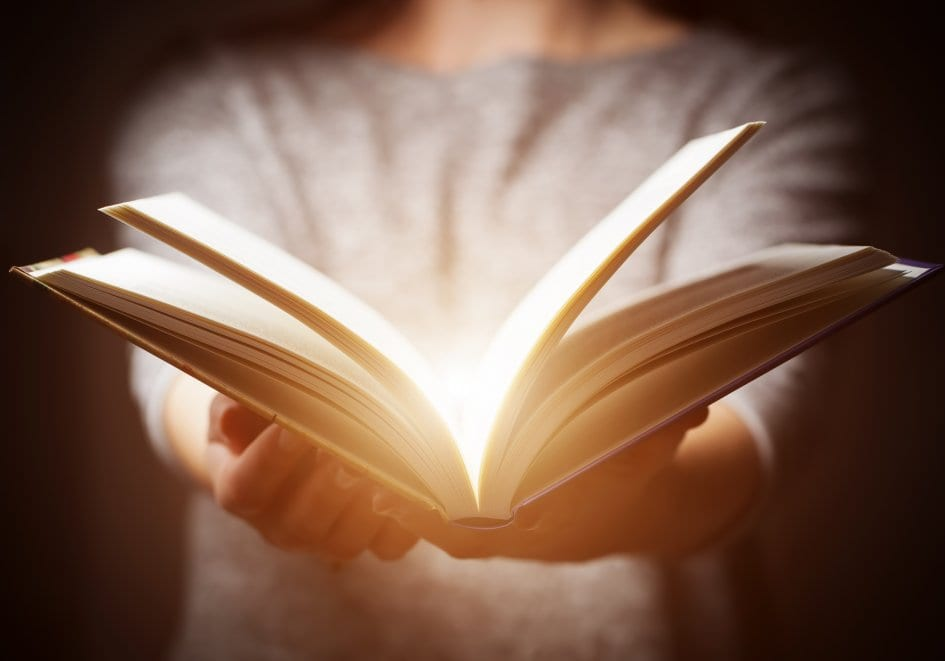 book in hands opening up