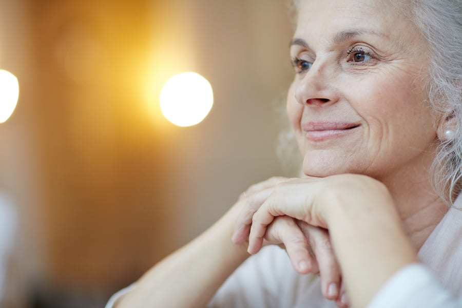 woman looking into space smiling