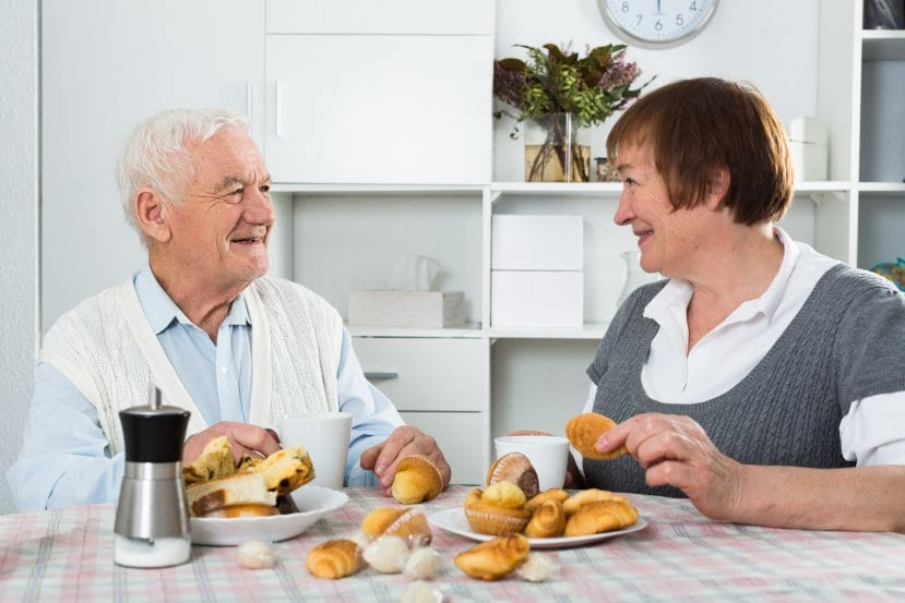 woman and man talking over biscuits