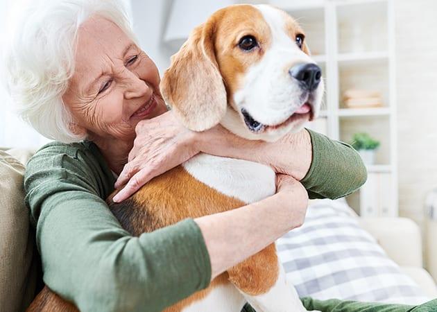 woman holding dog smiling
