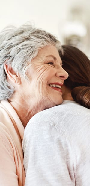 two women hugging hospice care