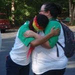 Campers embrace during an activity