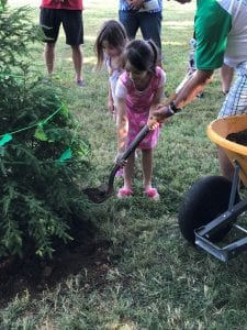 2 campers planting the Evergreen Tree